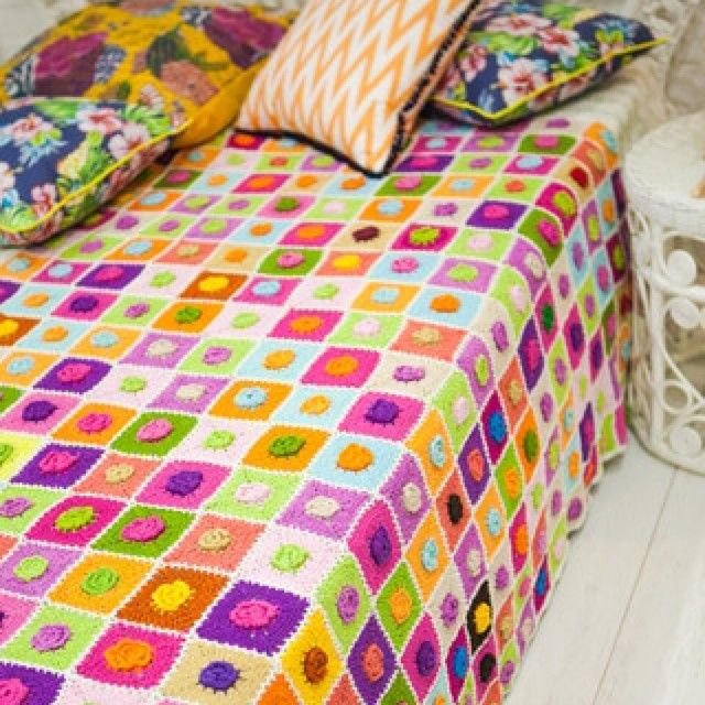 Our beautiful crochet floral blanket parked with some of our favourite patterned cushions.