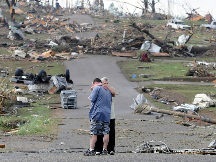 A mother comforts her son in Concord, Alabama, near his house which was completely destroyed by a tornado in April.  (AP / Jeff Roberts)