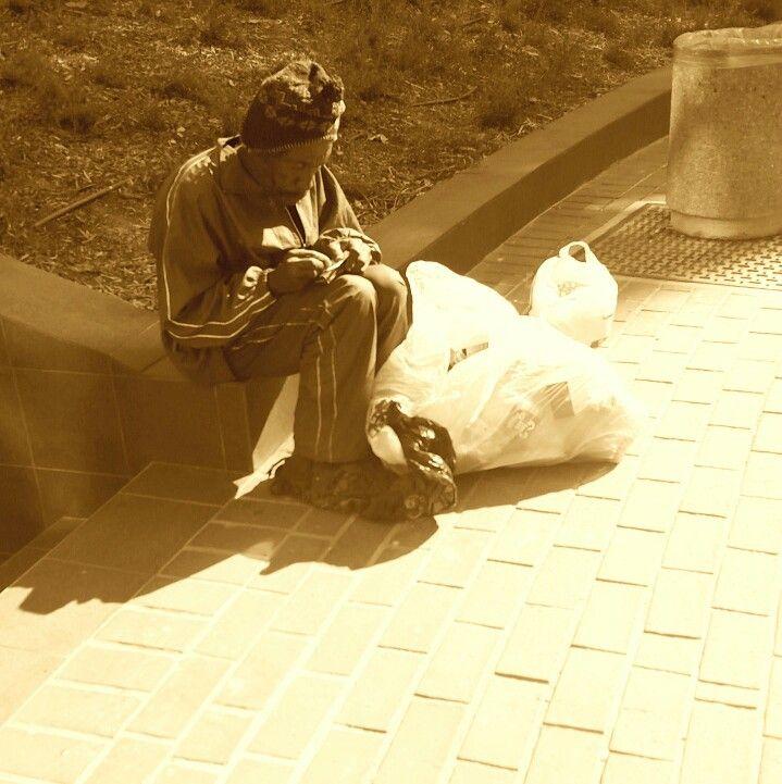 Vagrant catching cold winter sun.  Johannesburg  city