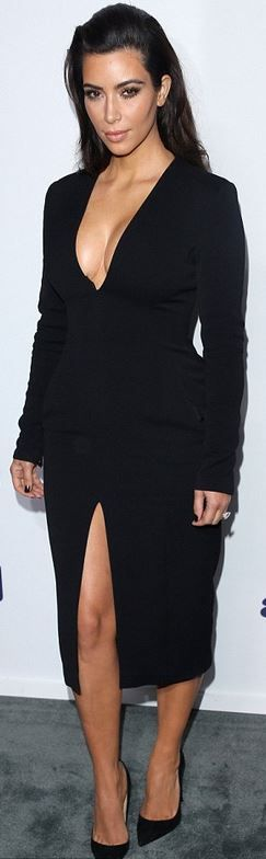 Who made  Kim Kardashian's blck long sleeve dress and suede pumps that she wore in New York?