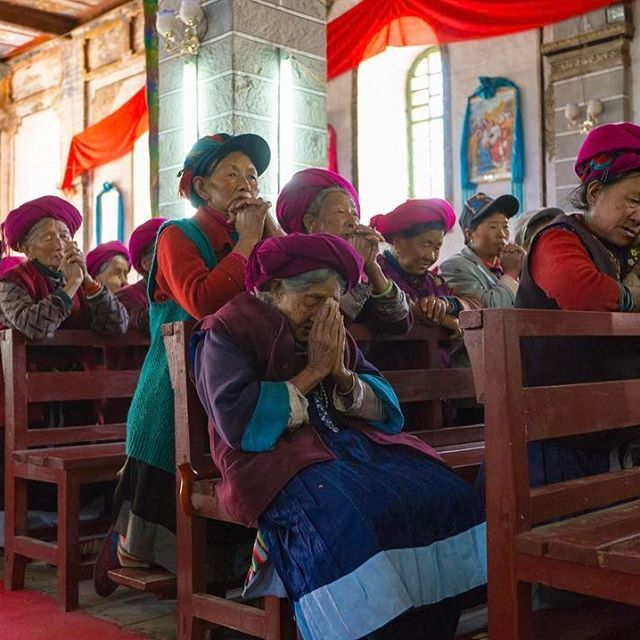 Elderly Tibetan people pray during a Sunday service at a Catholic church in the village of Cizhong in Diqing Tibetan Autonomous Prefecture in Yunnan Province. The church was built by French missionaries more than 100 years ago. Photo by @yamashitaphoto. See more of his work at supchina.com/photos. #china #chinanews #yunnan #church #cizhong #tibet