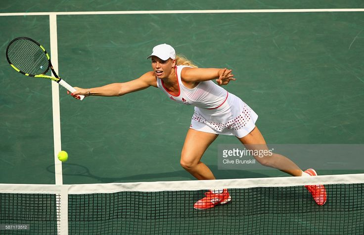 Caroline Wozniacki of Denmark plays a forehand during the Women's Singles second round match against Petra Kvitova of the Czech Republic on Day 3 of the Rio 2016 Olympic Games at the Olympic Tennis Centre on August 8, 2016 in Rio de Janeiro, Brazil.