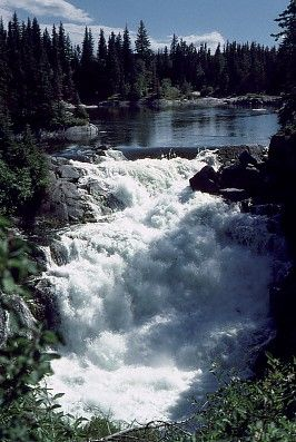 Arguably Saskatchewan's most famous waterfall, Nistowiak Falls is a 10 metre drop on the Rapid River as it runs into the Churchill below Stanley Mission. 1980 canoe trip.