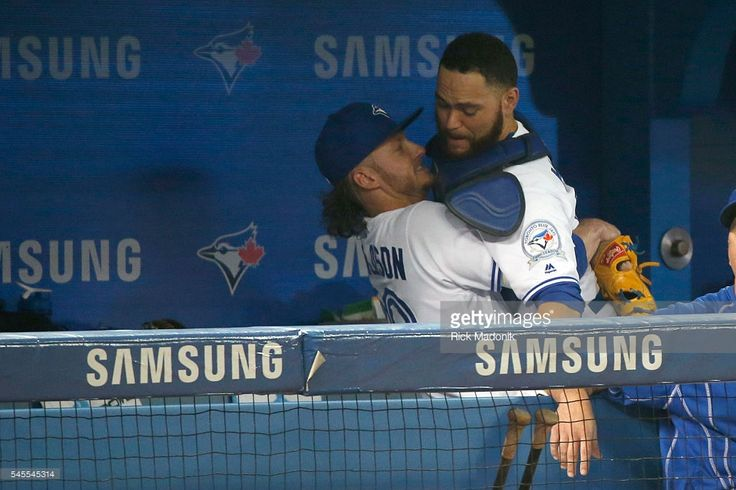 What a pic, lol! Toronto Blue Jays third baseman Josh Donaldson (20) gives Toronto Blue Jays catcher Russell Martin (55) a lift in the dug out prior to taking the field for the game. Toronto Blue Jays V Detroit Tigers in regular season play of MLB action at Rogers Centre. Toronto Star/Rick Madonik