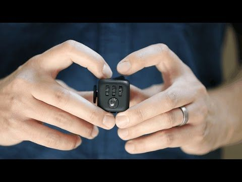 An unusually addicting, high-quality desk toy designed to help you focus. Fidget at work, in class, and at home in style. Fidget Cube has six sides. Each side features something to fidget with: Click.