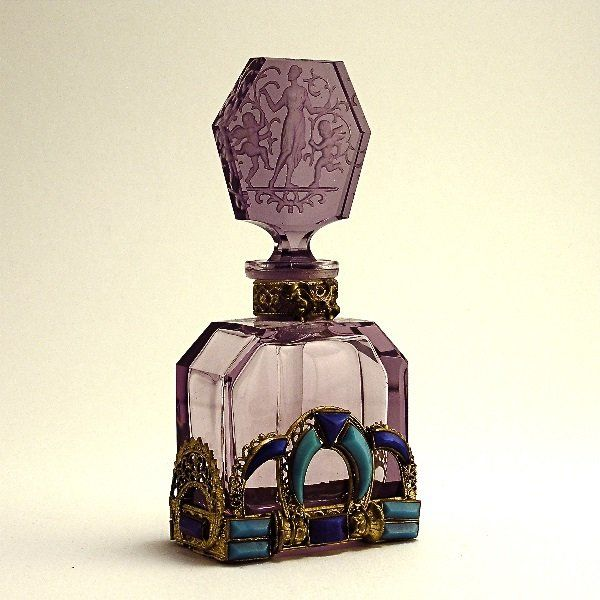 1920s Hoffman perfume bottle and intaglio stopper in amethyst crystal with Egyptian style enamel and jeweled metalwork matching front and back, dauber. 4 7/8 in.