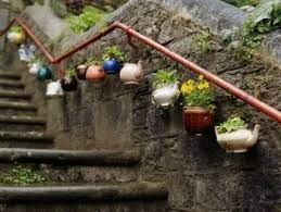 This is so adorable! just by using some old tea pots!