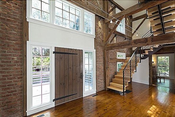 The staircase is a little too modern to go with the rest of the look and feel of this house, which I love. The barn style door and open floor plan is great. I'd love to convert an old barn into a home!