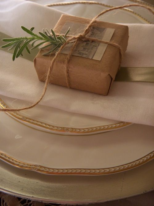 homemade soaps wrapped in brown paper and tied with string and rosemary