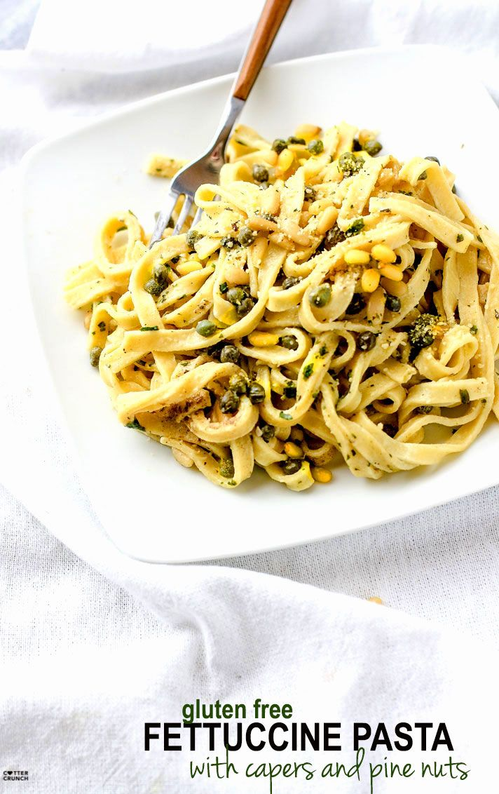 Healthy Fettuccine Pasta with Capers, Pine Nuts, and tossed in an herbed greek yogurt sauce!. This fettuccine recipe is light in flavor but also a bit creamy and comforting. A gluten free fettuccine pasta dish that's ready in 30 minutes and will nourish you and your whole family. #paleo pasta with @cap
