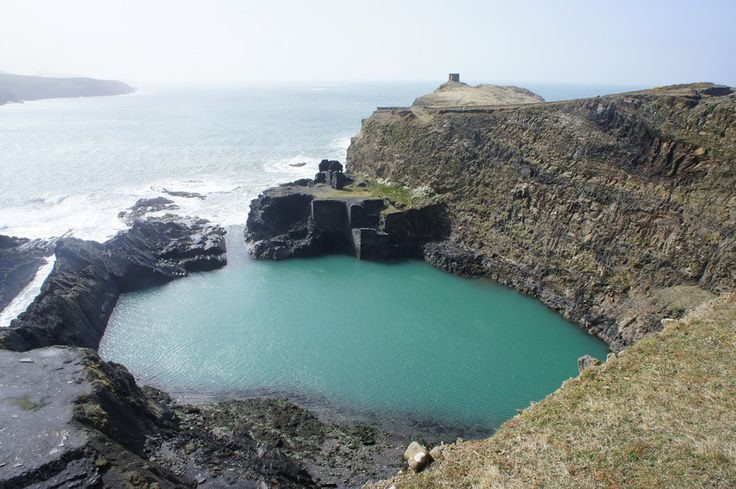 Blue Lagoon, Pembrokeshire. For a breathtaking view, fresh air, and maybe even a swim, the blue lagoon in Pembrokeshire is the perfect location. The lagoon's water gets its distinctive colour from the slate cliffs that surround it | 25 Places In Wales You Won't Believe Are Real