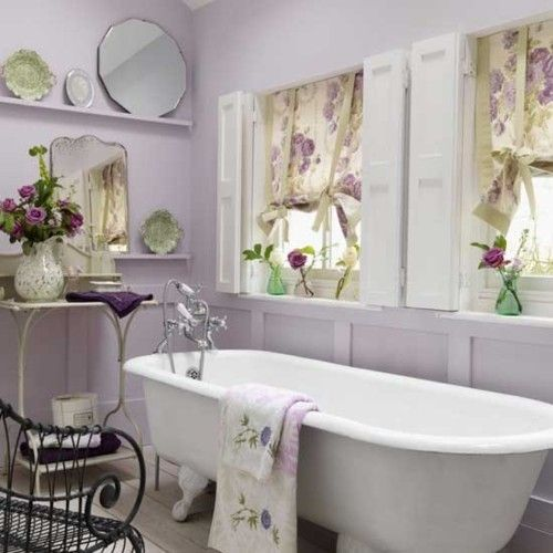 Tub, mirrors, shuttered windows, wash stand.....and the lavendar walls!