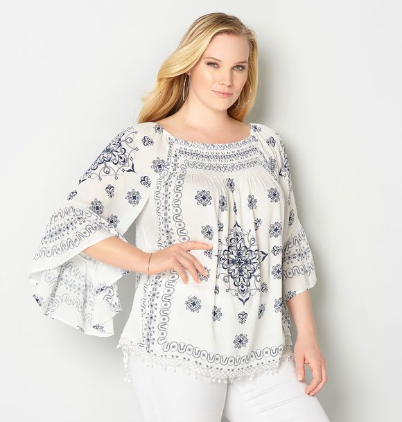 Find trendy plus size tops like the Smocked Off the Shoulder Peasant Top available online at avenue.com. Avenue Store