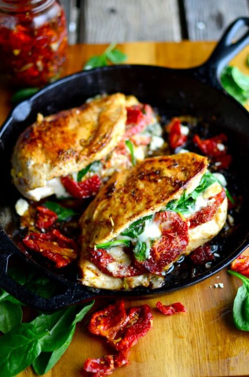 Sundried Tomato, Spinach, and Cheese Stuffed Chicken (via http://www.yammiesnoshery.com)