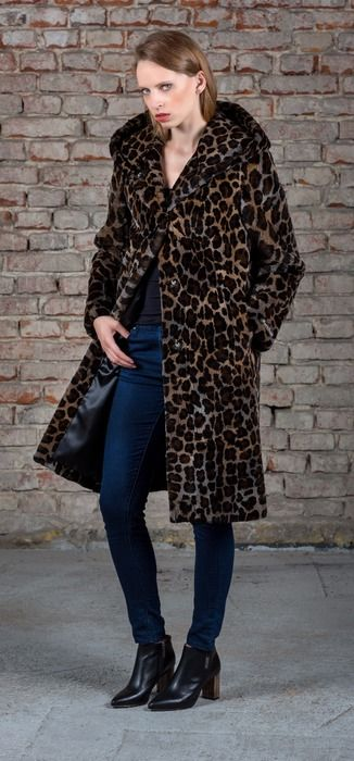 SC  real fur coat is made of sheared muskrat back fur designed to dark leopard style.