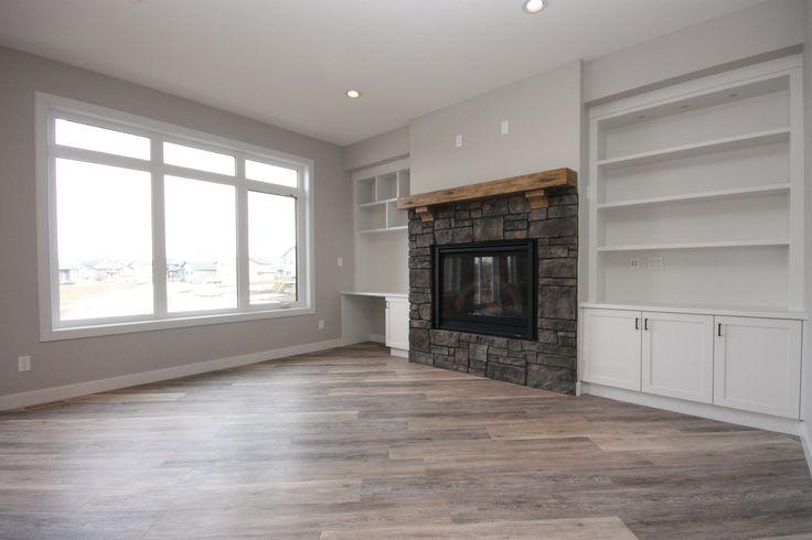 Fireplace, stone surround, timber mantel, built-in shelving, custom shelves, living room