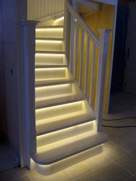 "LED Light strips on stairway. Great idea for basement stairs. ESPECIALLY if there is a ""movie theatre"" in your basement"