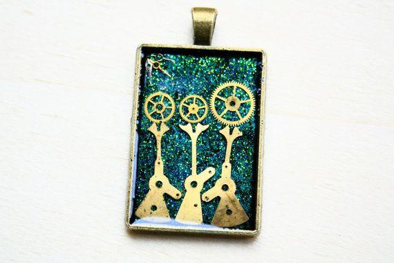 Steampunk pendant with clock/watch gears by JeanneNoireRepunked