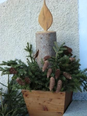 candle made from log in wooden planter