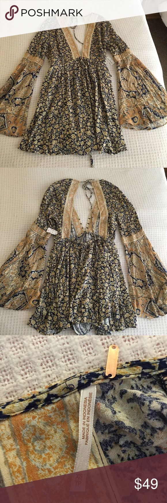 Free People dress, XS, new with tags Beautiful, multicolored and flowing dress. Brand new with tag and still available at Macy's. I love it but it's a bit too small. Can bundle with other items. Free People Dresses Midi