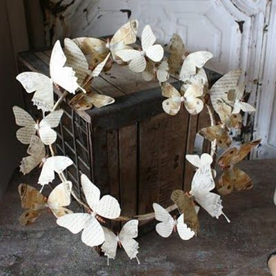 butterfly wreath. Im making mine out of pages from old poetry books and sheet mu