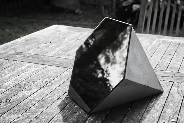 Hexagonal mirror, part of studiokyss concrete deskware range, 2013.
