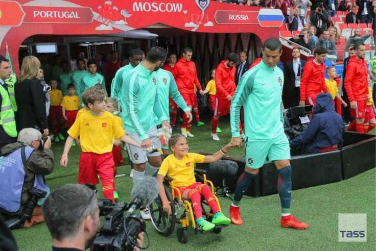 Worlds top footballer Cristiano Ronaldo walked out onto the field before the start of the Russia-Portugal football match of the 2017 Confederations Cup accompanied by a disabled ten-year old girl Polina Khayeredinova.  This is the first time in the history of FIFA when a player was escorted by a disabled child.  This historic event was made possible by the Confederations Cups sponsor McDonalds showing that football is open to disabled children and lets them get involved in international…