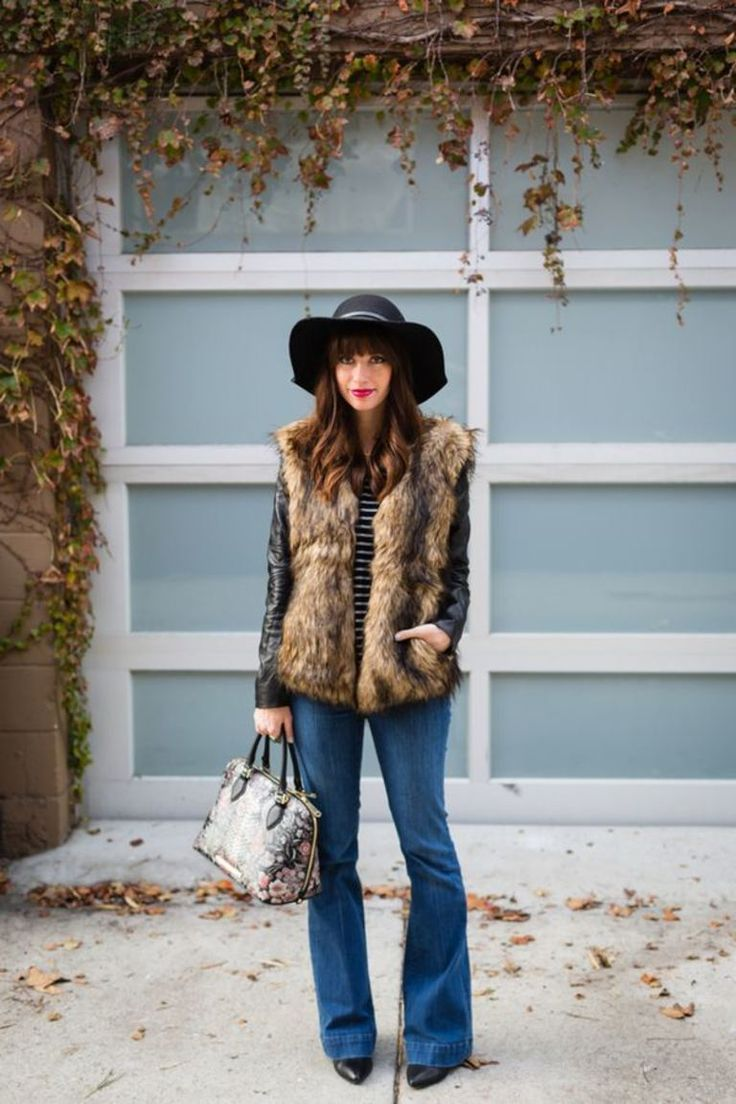 Flare jeans are hot for summer. Love this denim boho look with furry vest and fl…