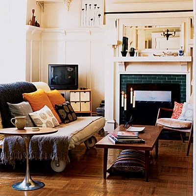 This living room can easily be transformed into a guest room.The futon unfolds into a bed, and the coffee table becomes a nightstand. Futon casters make for quick rearranging.