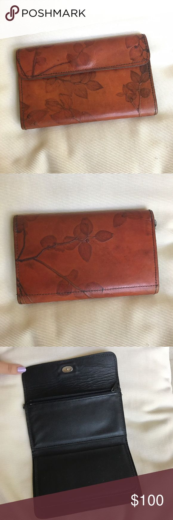 CL Whiting Handcrafted Leather Wallet Handmade leather women's secretariat from the beautiful collection by CL Whiting. Each leather piece is handcrafted and artfully created so no two pieces are alike. Brown leather outer and black leather interior. Portions of the leaf design show wear and some of the leather shoes wrinkling. Price firm. CL Whiting Bags Wallets