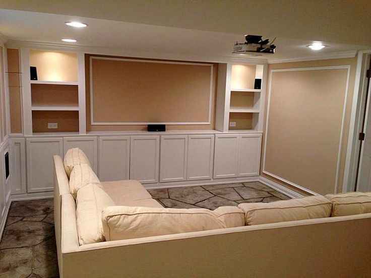 Custom Cabinets And Book Shelves In A Home Movie Theater Hand Carved Concrete Flagstone Floor