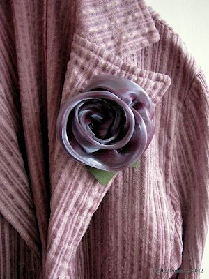 Pretty organza rose tutorial (would make a sweet brooch) at The Little Treasures.