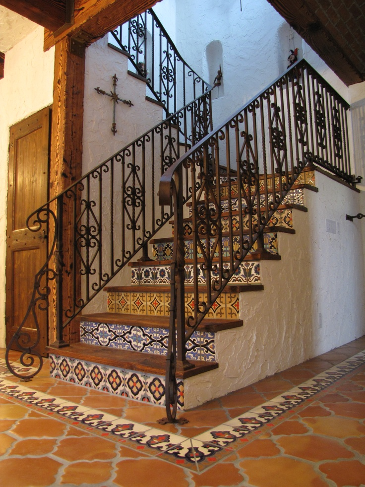 What a stunning application of the Riviera pattern using Saltillo Terracotta tile.  It's a beautiful eye-catcher alongside a stair case covered with relief painted Talavera Mexican tiles. Sold by Rustico Tile and Stone (www.saltillotileconnection.com)