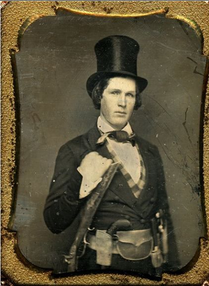 ca. 1860's, [portrait of a well-armed gentleman with a pepper box pistol, Kentucky rifle and a top hat