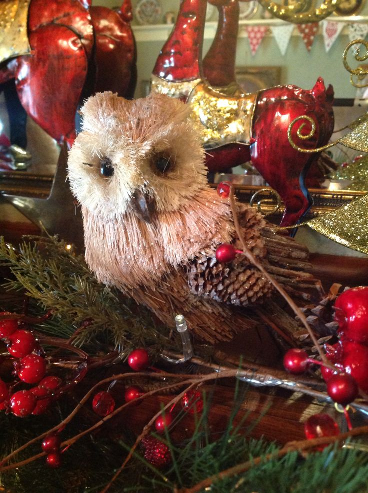 Christmas at ELMS-HAVEN. An owl amongst the garland on the mantle piece in the lounge room.