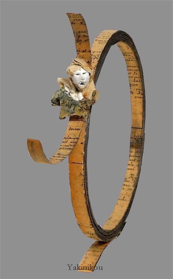 compression papier ancien manuscrit histoire de l'Art et sculpture tête