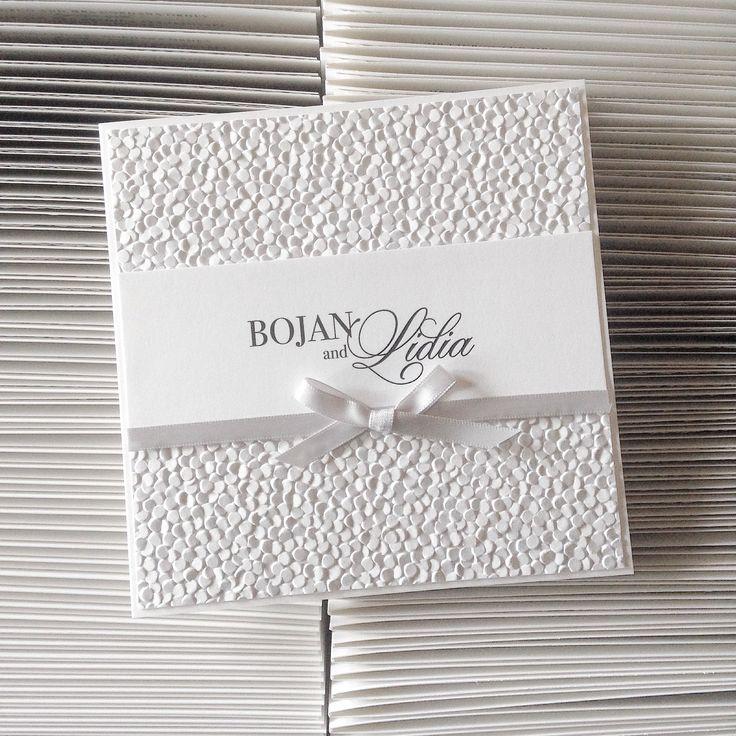 Classic square wedding invitation with pebble embossed ...