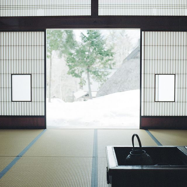 Japanese style room, washitsu.  Typical with tatami flooring, sliding door and shoji - translucent paper over a frame of wood which holds together a lattice of wood or bamboo.  Love when there is a sunken hearth.