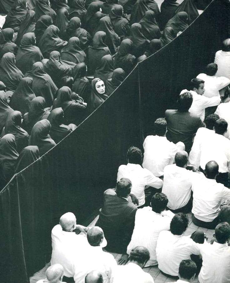 "SHIRIN NESHAT  (b. 1957)  ""FERVOR"" (CROWD FROM BACK, WOMAN LOOKING OVER  HER SHOULDER)"