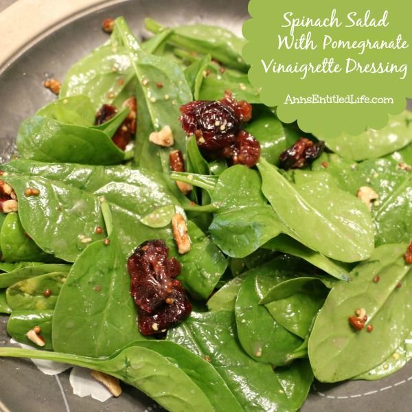 Spinach Salad with Pomegranate Vinaigrette Dressing Recipe; Fresh spinach, dried cranberries and walnuts tossed with a tangy, great tasting pomegranate dressing. The results are wonderfully unexpected, and completely delicious.  http://www.annsentitledlife.com/recipes/spinach-salad-with-pomegranate-vinaigrette-dressing-recipe/