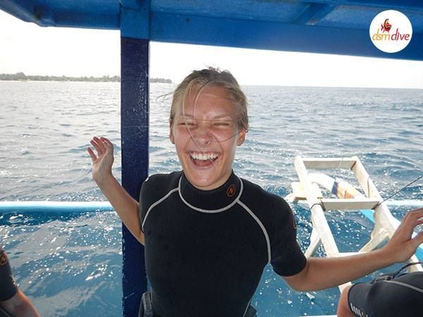 She just got certified as a PADI Open Water Diver. Look how happy she is ;-)