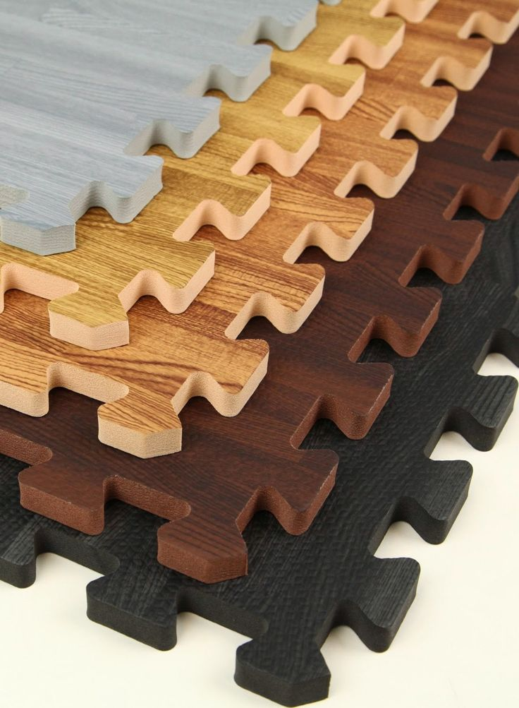 Interlocking Faux Wood Puzzle Mats - much nicer in a kid's playroom then those bright ones they sell...