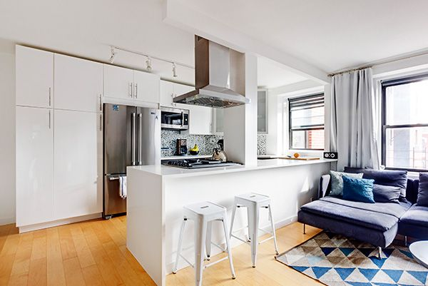 """""""I finally decided on the Ringhult glossy cabinet series from Ikea for the kitchen with white upper cabinets and gray on the bottom, split by a snow white quartz countertop."""" - Rima"""