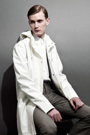 Stutterheim raincoat, $735; barneys.com.Jil Sander shirt; jilsander.com. Hermès pants; hermes.com.