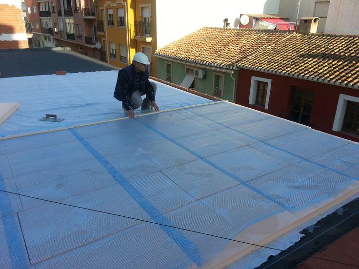 cubierta invertida: capa de geotextil+poliestireno extruído (8cm), en cubierta plana.