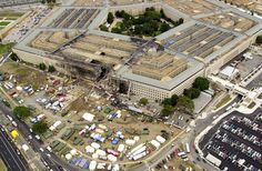 FBI agents, fire fighters, rescue workers and engineers work at the Pentagon crash site on Sept. 14, 2001, where a high-jacked American Airlines flight slammed into the building on Sept. 11. The terrorist attack caused extensive damage to the west face of the building and followed similar attacks on the twin towers of the World Trade Center in New York City. DoD photo by Tech. Sgt. Cedric H. Rudisill. (Released)