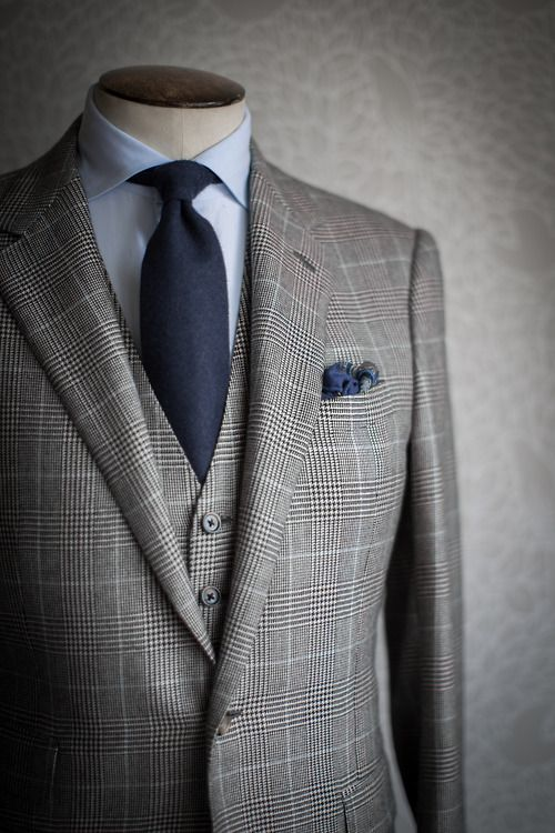 Not this exact suit in the photo but the idea of a grey sharkskin suit with Dark Blue tie w/Blue shirt