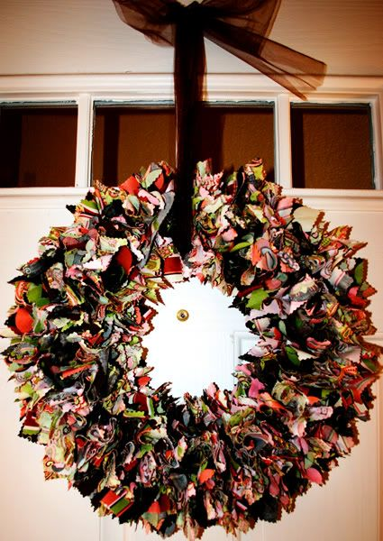 Easy way to make a fabric wreath. Cut fabric into squares then poke into styrofoam wreath (with glue).