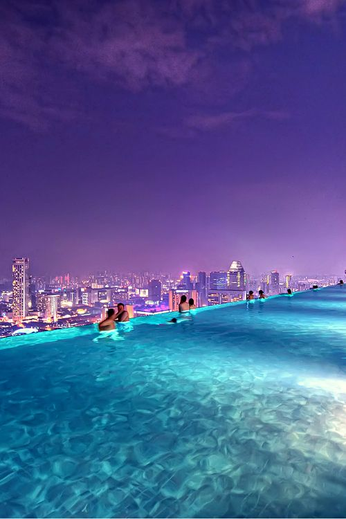 Rooftop Pool, Marina Bay Sands Resort, Singapore.  An amazing view looking towards the Sofitel and Raffles Hotels.