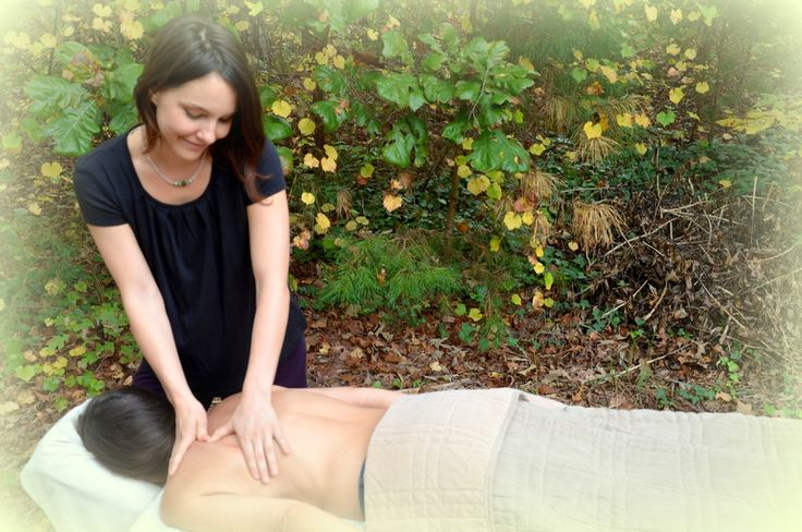 Kinsey working her magic! Yes, you can have a massage in the woods!